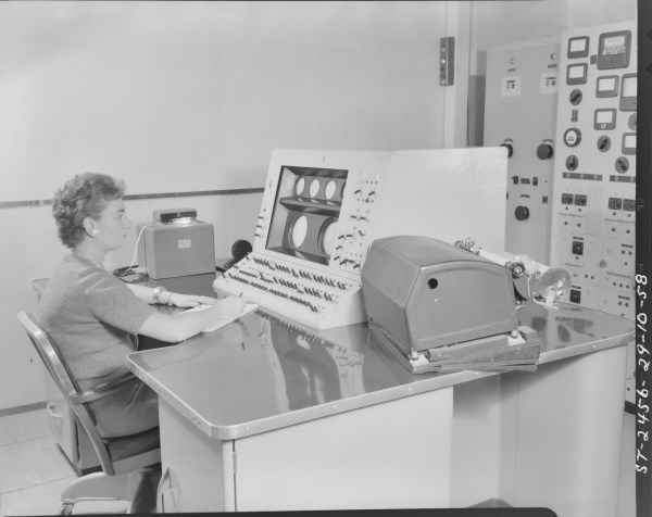 The main console. I believe the console operator is Rita Lahey but this has yet to be confirmed. The Creed photo-tape reader is on the left of the console and the Creed printer is on the right. Photo courtesy of the NRC Archives.