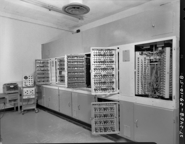 This was the area between the two equiment bays.The open doors provide a good shot of just some of the 4600 tubes that heated up the room when running. The open area to the right is the magnetic drum memory unit. Also shown are the trusty Tektronix 545 oscilloscope and a well-used AVO tube tester. Photo courtesy of the NRC Archives.